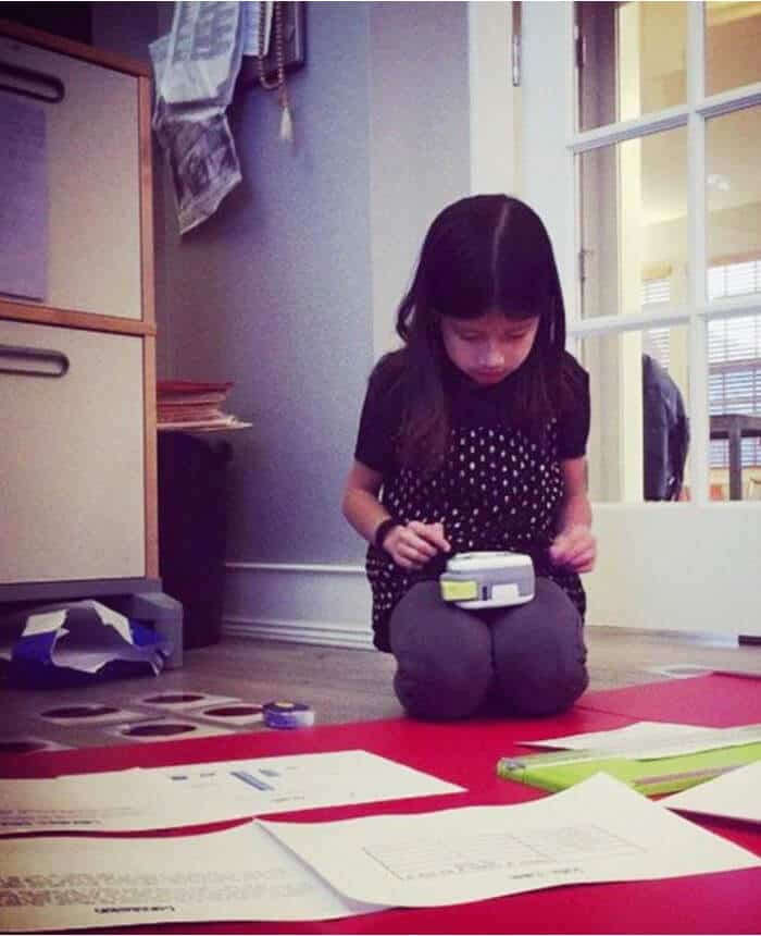 Young girl making labels