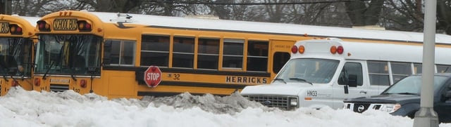 Public school buses snowed in and unable to move