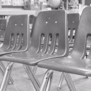Black and white public school classroom seating