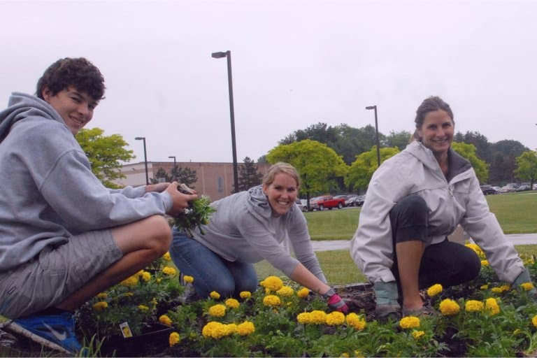 Homeschool families engaging in community service