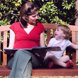 Mother reading a children's book to her daughter