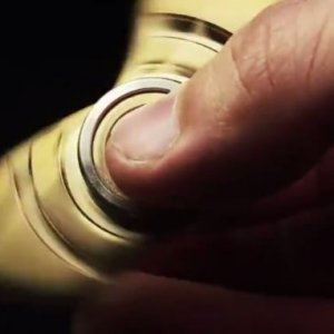 A gold fidget spinner in motion