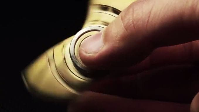 A gold fidget spinner in motion
