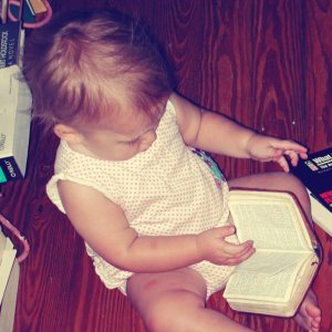 Kid reading a baby's Bible