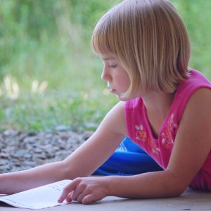 Blond girl journaling in order to become more mindful of herself