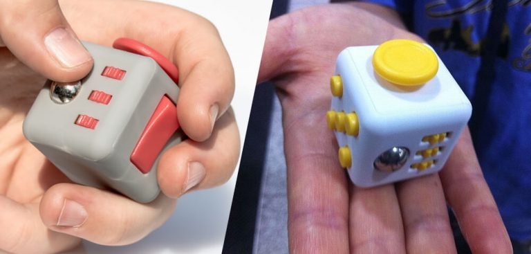 Two different fidget cubes in the palm of your hand