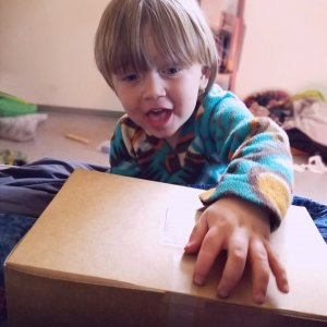 an excited child with a new subscription box