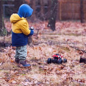 A child playing with a remote controlled car