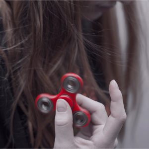 Girl with a red fidget spinner