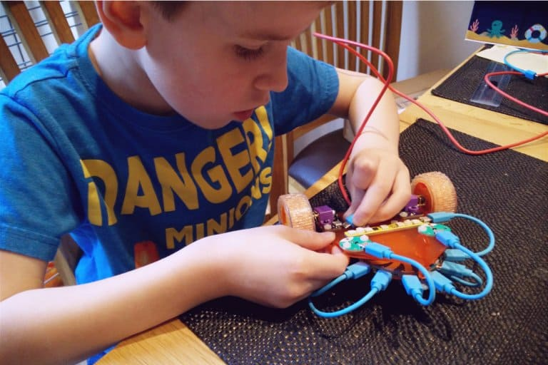 A kid building his own robot from a kit